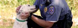 Officer and White Dog